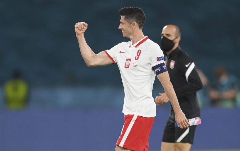 Poland's Robert Lewandowski reacts after the Euro 2020 soccer championship group E match between Spain and Poland at La Cartuja stadium in Seville, Spain, Saturday, June 19, 2021. (David Ramos/Pool via AP)