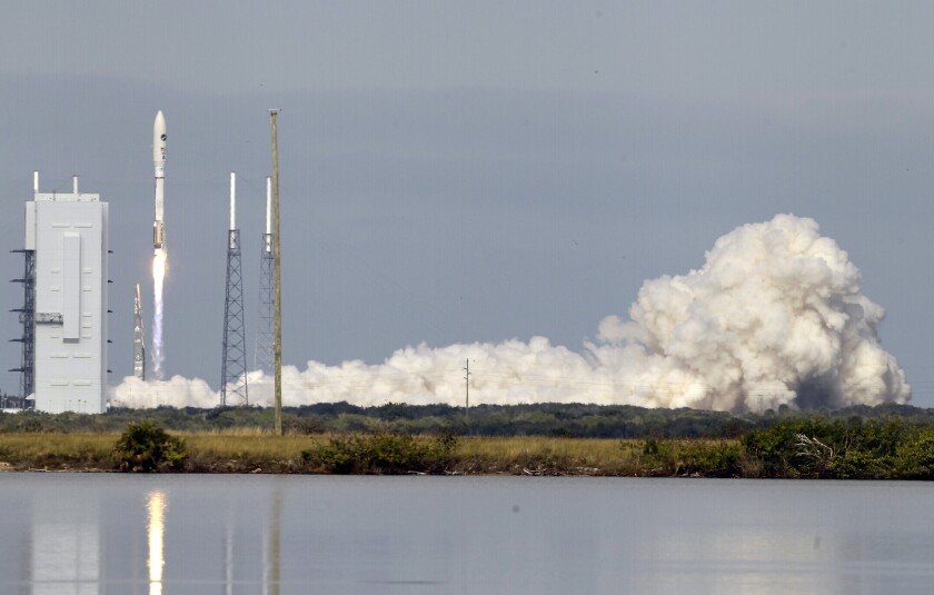 An Atlas V rocket, carrying an X-37B experimental robotic space plane, lifts off from Cape Canaveral Air Force Station in Florida.