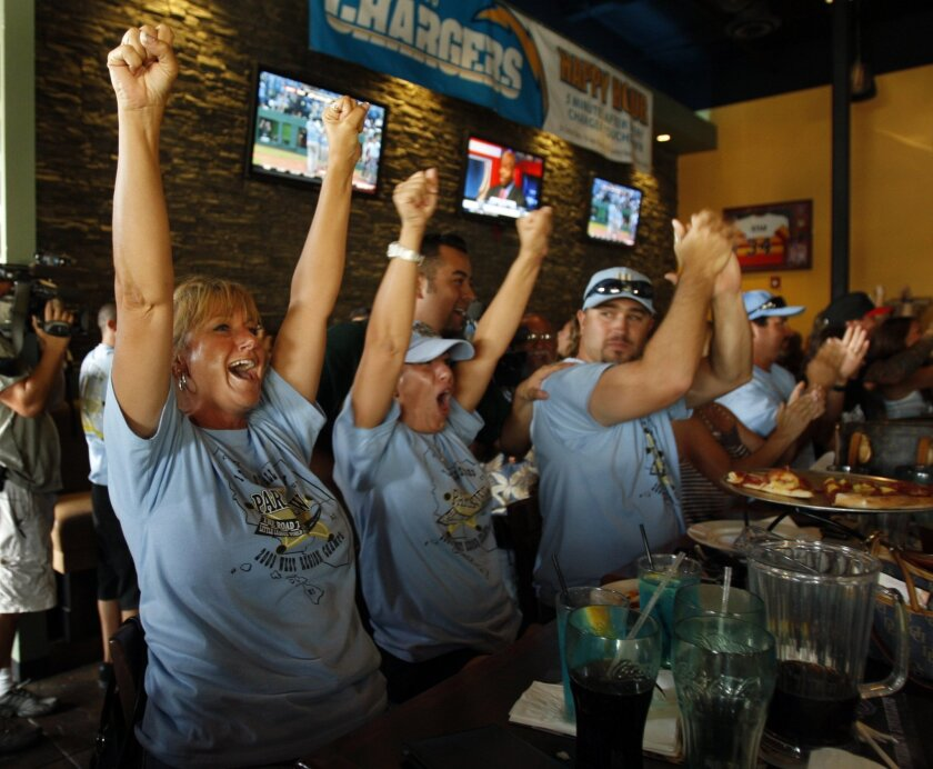 Jen Snyder (from left), Rita Desena and Jason Desena celebrated a home run by the Park View Little League team as they watched the U.S. Championship game yesterday at Oggi's Pizza & Brewing Company in Eastlake. (K.C. Alfred / Union-Tribune)