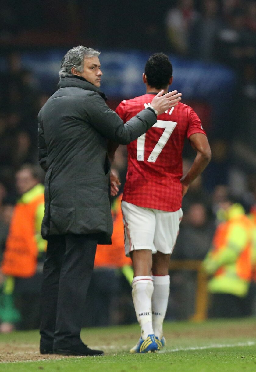 FILE- In this Tuesday, March 5, 2013 file photo, the then Real Madrid's coach Jose Mourinho pats Manchester United's Nani on the back as he leaves the field after being shown a red card during the Champions League round of 16 soccer match at Old Trafford Stadium, Manchester, England. Manchester Uni