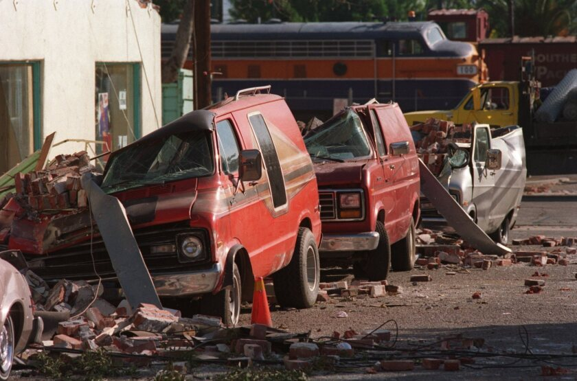 A brick wall collapsed on cars that lined Fillmore Street at Main Street after the 1994 Northridge earthquake in Fillmore.