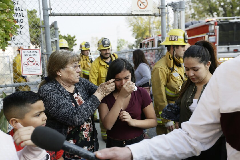 Student Marianna Torres, 11, center, cries as she evacuates Park Avenue Elementary School after jet fuel fell on the school on Tuesday in Cudahy.