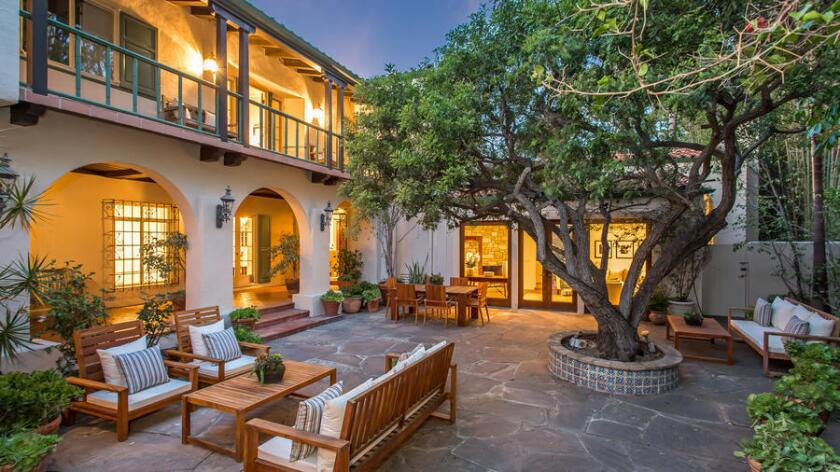 The 6,167-square-foot Mediterranean Revival-style house, designed by L.G. Scherer and built in 1932, sits on half an acre of grounds in Little Holmby.