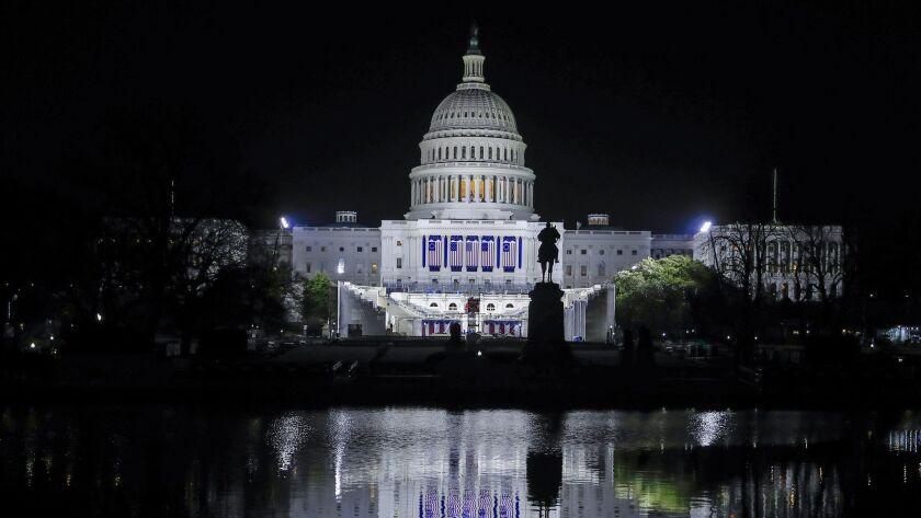 The U.S. Capitol is illuminated in advance of Donald Trump's inauguration in Washington, D.C.
