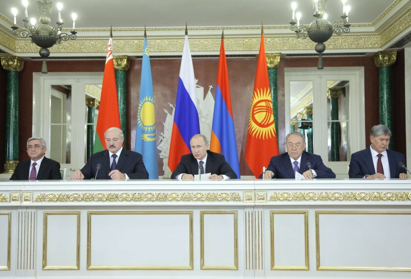 Russian President Vladimir Putin, center, is flanked from left to right by the presidents of Armenia, Belarus, Kazakhstan and Kyrgyzstan at the ceremonial creation of the Eurasian Economic Union on Tuesday.