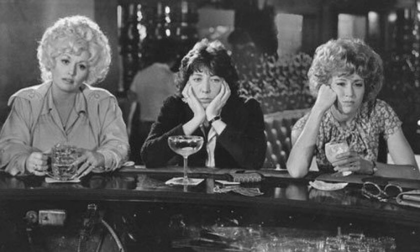 """Dolly Parton, left, with Lily Tomlin and Jane Fonda, in the 1980 film """"9 to 5."""""""