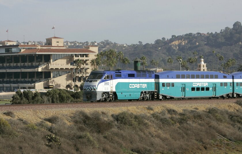 A Coaster train made its way past the Del Mar Fairgrounds. SANDAG is considering a proposal for a new rail access plan for the Del Mar Fairgrounds. (Charlie Neuman / Union-Tribune)