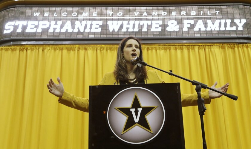 CORRECTS TO WHITE STILL COACHING IN THE WNBA - Stephanie White, head coach of the WNBA's Indiana Fever, speaks during an NCAA college baseball news conference where she was introduced as the new's women's basketball coach at Vanderbilt University, Wednesday, May 25, 2016, in Nashville, Tenn. White will be finishing out the WNBA season coaching the Fever. (AP Photo/Mark Humphrey)