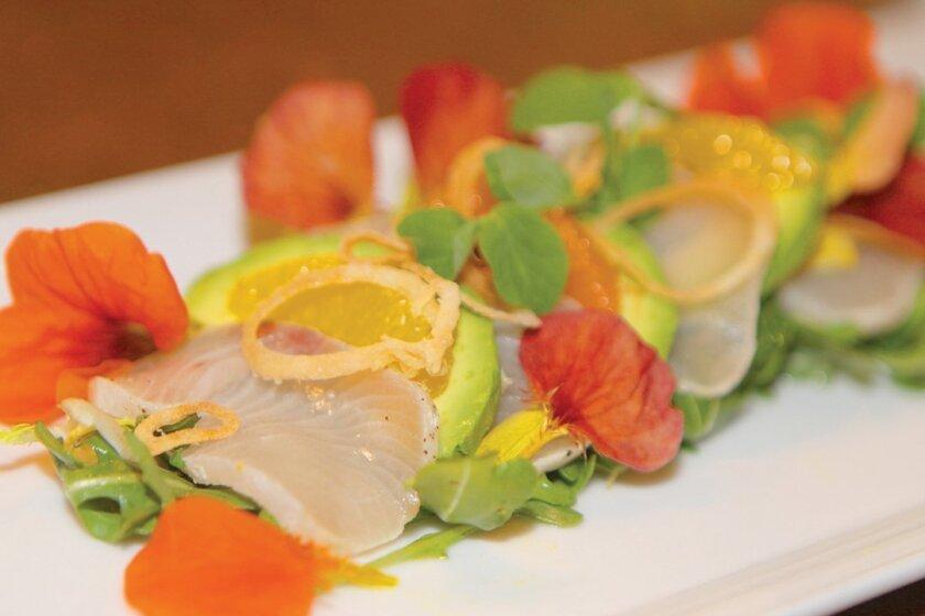 Hamachi: Sushi-grade fish with capers, shallots, ginger, citrus, pasilla aoli, and Okinawa potato chips. Photos by Daniel K. Lew
