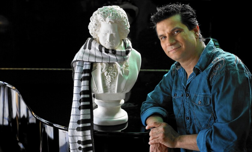 Video game composer Tommy Tallarico next to a bust of Beethoven at his home in San Juan Capistrano on May 5, 2015.