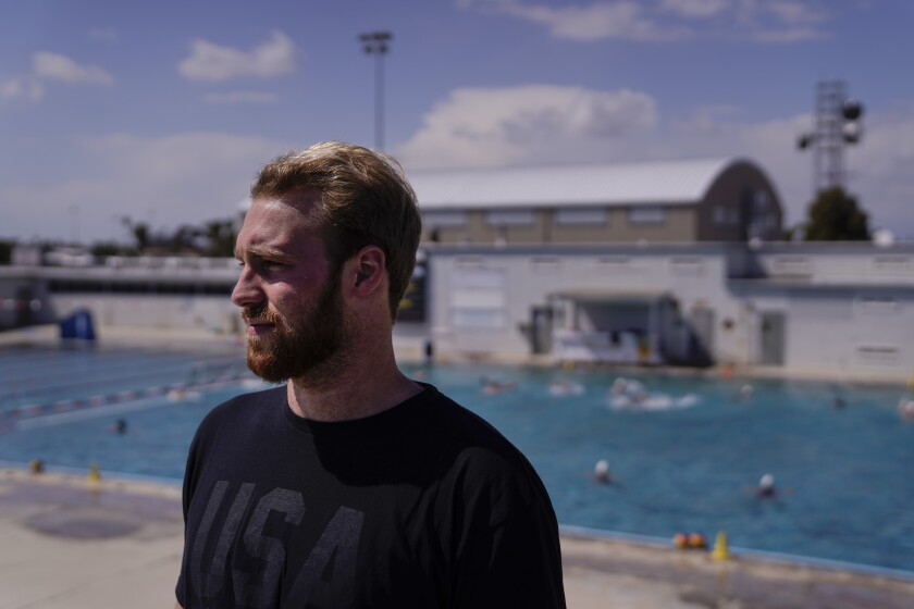 \Water polo player Marko Vavic pauses for photos at MWR Aquatic Training Center in Los Alamitos, Calif., Tuesday, April 27, 2021. Two years after his father, Jovan, was arrested as part of a college admissions investigation dubbed Operation Varsity Blues, Vavic is pushing for a spot on the U.S. men's Olympic water polo team. (AP Photo/Jae C. Hong)