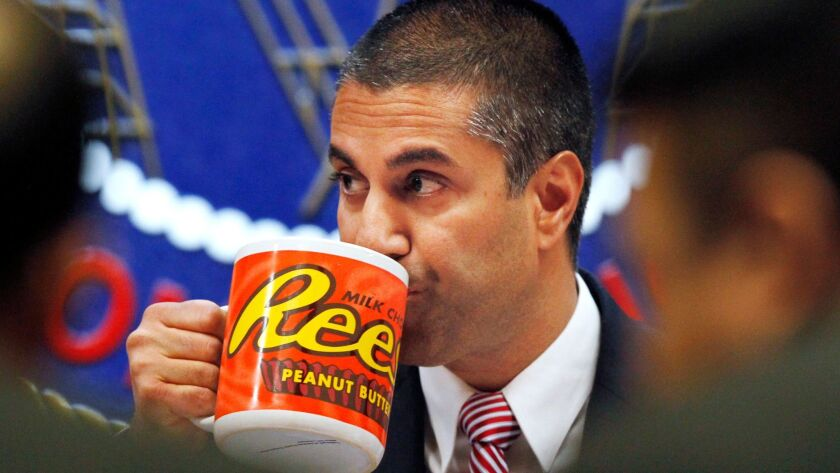 Federal Communications Commission Chairman Ajit Pai drinks from a giant mug during a December meeting where the FCC voted on net neutrality. Burger King had a similar mug in its net neutrality ad.