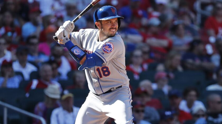 New York Mets' Travis d'Arnaud bats during the eighth inning of a baseball game against the St. Loui