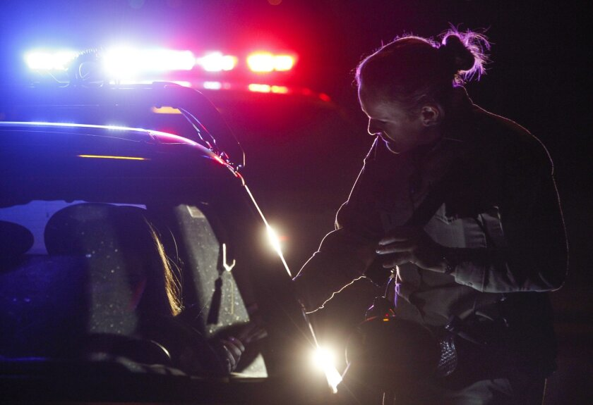 Sheriff's Deputy Kristy Drilling hands a driver back their license and allowed to drive on after the driver was pulled over by Drilling.