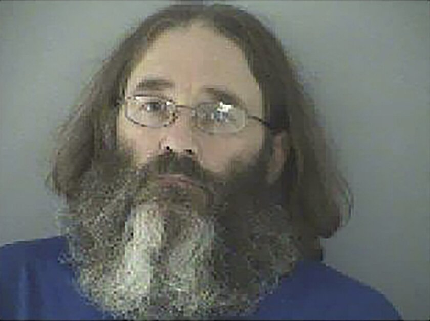 FILE - This undated file photo made available by the Butler County Jail in Virginia shows James T. Hammes of Lexington, Ky. Hammes is scheduled to be sentenced June 22, 2016, after pleading guilty in 2015 to wire fraud and agreeing to pay back millions embezzled from his employer, a Cincinnati-base