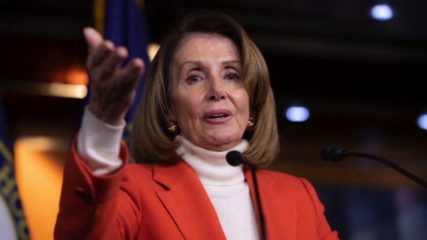 House Speaker Nancy Pelosi talks to reporters during a news conference at the Capitol in Washington.