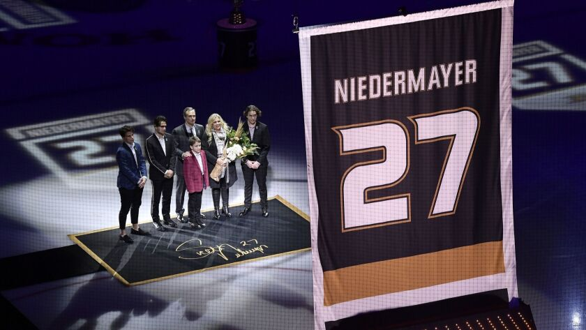 Former Ducks defenseman Scott Niedermayer watches along with his family as his jersey is retired prior to the game between the Ducks and the Washington Capitals.