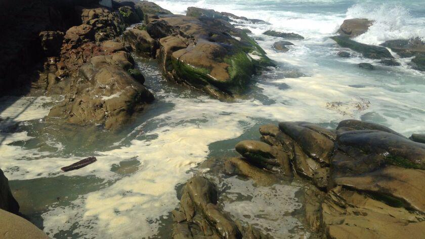 Foam accumulates at the Vista de la Playa beach access.