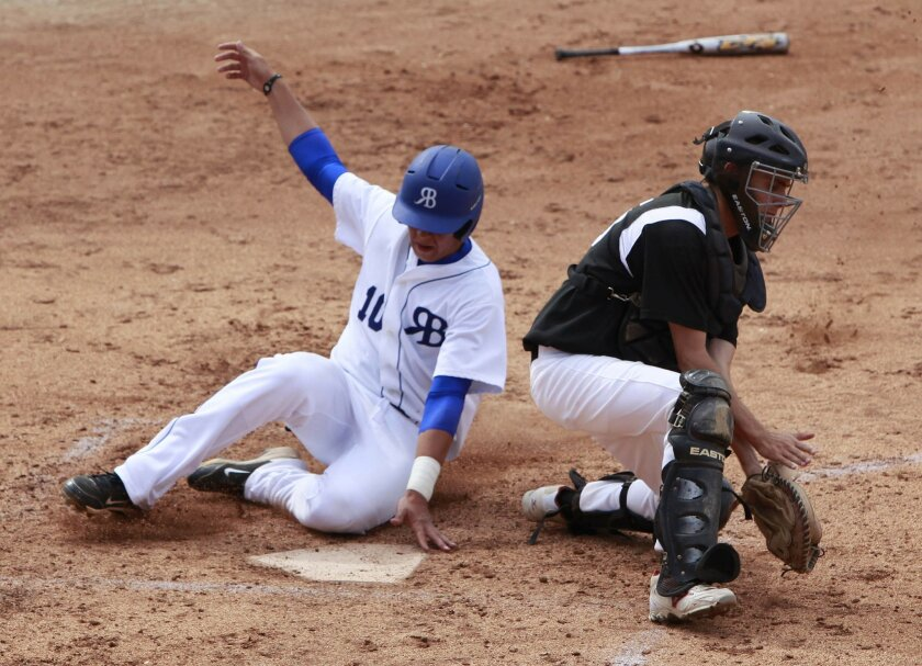 Rancho Bernardo baserunner Alex Jackson is safe at the plate as Vista catcher Brian Kirchmeier is unable to get around with the tag.