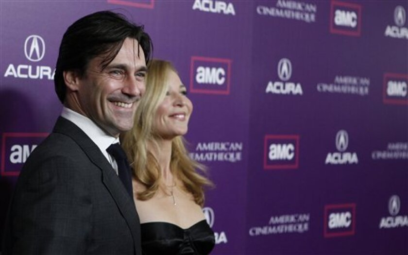 Jon Hamm, left, and his wife, Jennifer Westfeldt, arrive at the American Cinematheque Award gala honoring Samuel L. Jackson in Beverly Hills, Calif. on Monday, Dec. 1, 2008. (AP Photo/Matt Sayles)