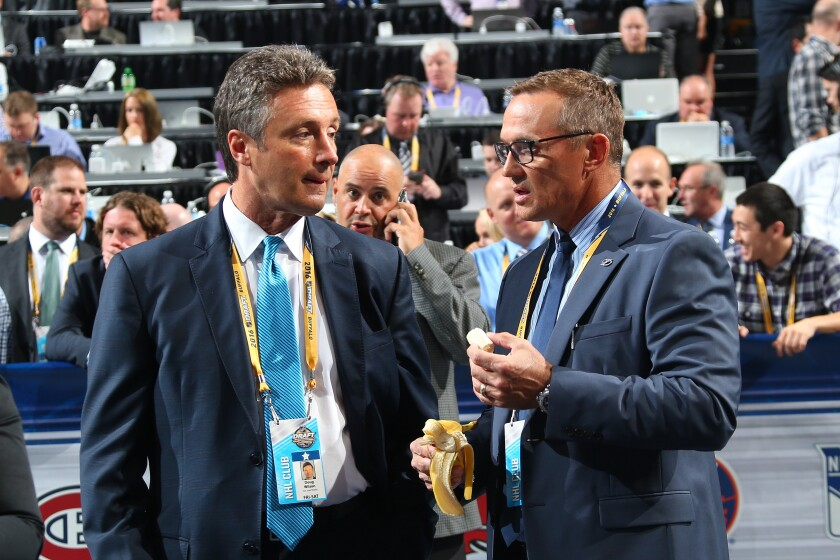 Sharks General Manager Doug Wilson, left, talks to Lightning General Manager Steve Yzerman during the 2016 NHL Draft on June 24, 2016.