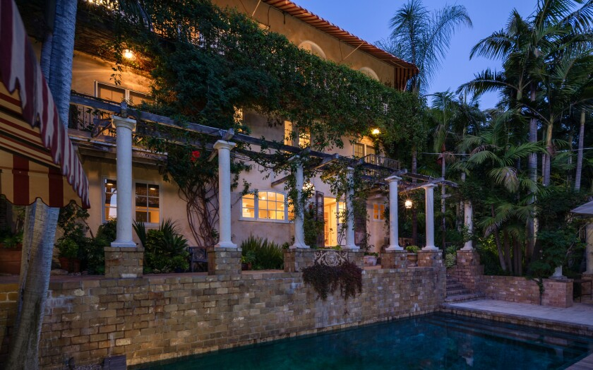 The three-story romantic villa opens to a secluded backyard with a swimming pool and spa.