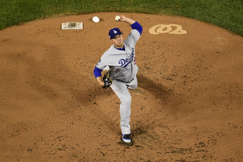 Dodgers pitcher Hyun-Jin Ryu delivers during Game 3 of the National League Division Series.