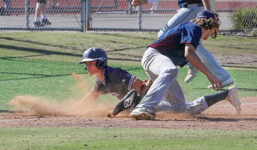 Luca Fernandez, of San Marcos, slides safely into third after hitting a two run triple. With late tag is Scripps Ranch's Gavin Hunter.