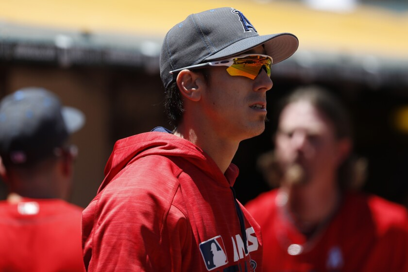 Tim Lincecum watches from the Angels dugout during a game in June.