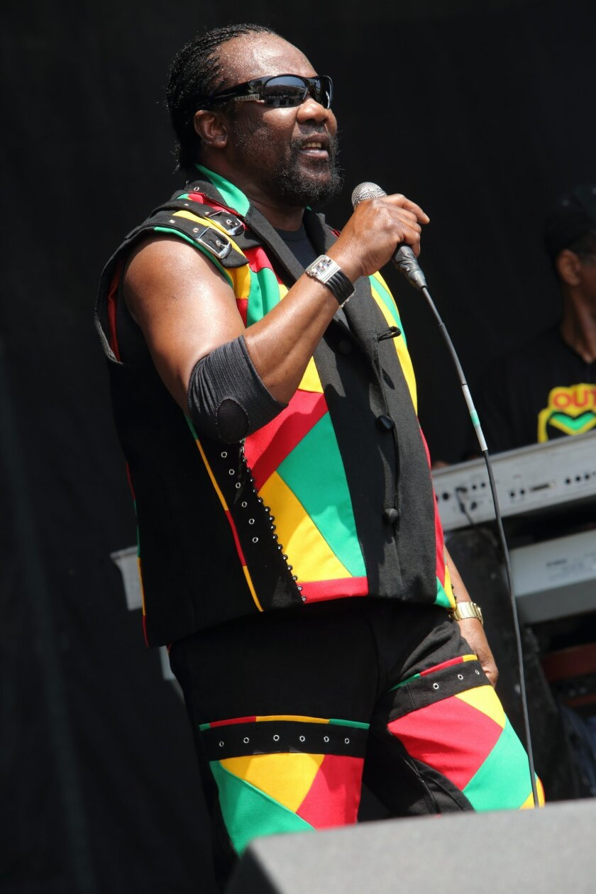 In this May 17, 2013 photo, Toots Hibbert, of Toots and the Maytals, performs at The Hangout Festival in Gulf Shores, Ala.