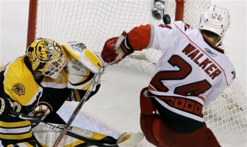 Carolina Hurricanes right wing Scott Walker (24) shoots the game-winning goal past Boston Bruins goalie Tim Thomas (30) in overtime during Game 7 of an NHL hockey Eastern Conference semifinal series, Thursday, May 14, 2009, in Boston. The Hurricanes beat the Bruins 3-2. (AP Photo/Charles Krupa)
