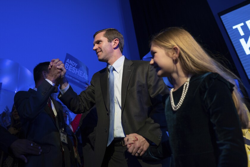 Democratic gubernatorial candidate and Kentucky Attorney General Andy Beshear walks with his daughter Lila to speak to supporters at the Kentucky Democratic Party election night watch event, Tuesday, Nov. 5, 2019, in Louisville, Ky. (AP Photo/Bryan Woolston)