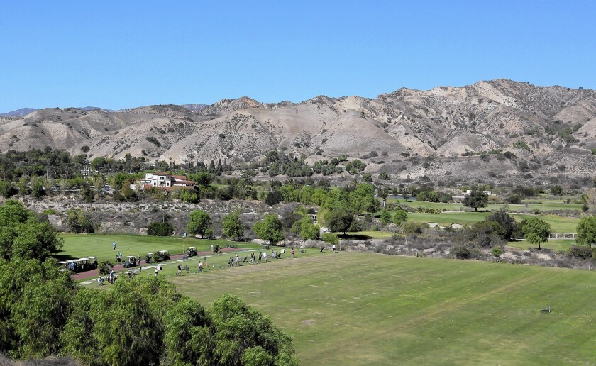 The mountains above the Angeles National Golf Club in Sunland are along one of four proposed tunnel routes.