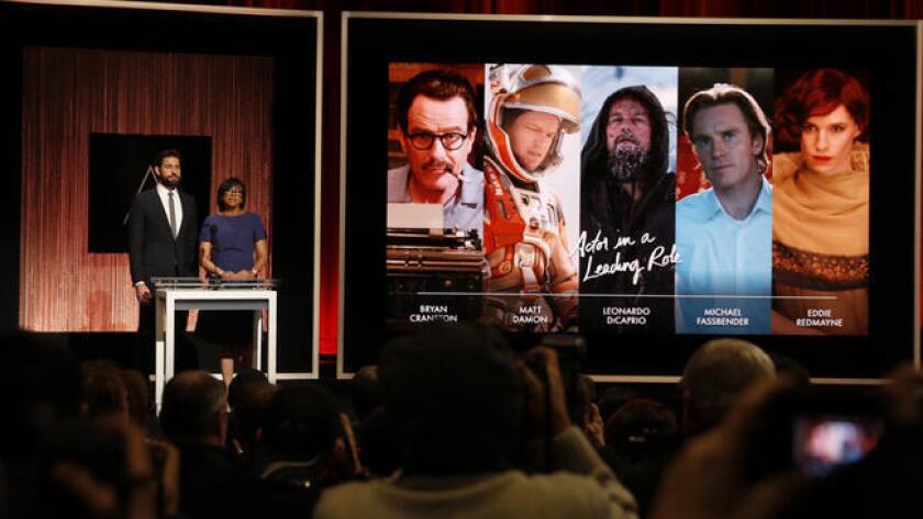 Actor John Krasinski, left, and Academy President Cheryl Boone Isaacs announce nominees for the lead actor category.
