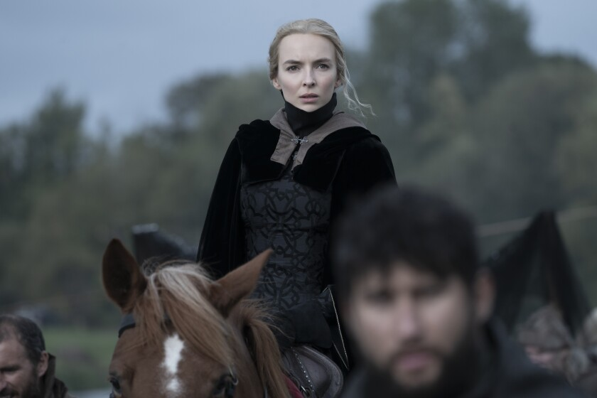 """A woman on horseback in the movie """"The Last Duel."""""""