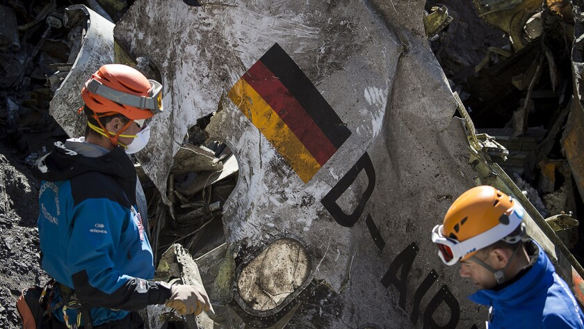 "Gendarmes and rescuers from the Gendarmerie High-Mountain Rescue Group working at the crash site of the Germanwings Airbus A320 on March 31, 2015. The co-pilot who is believed to have deliberately crashed a Germanwings jet in the French Alps may have ""rehearsed"" steering the plane into a rapid descent on an earlier flight, German daily Bild reported on May 6, 2015."