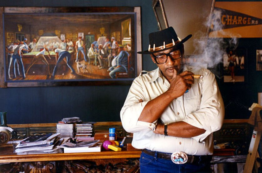"Ernie Barnes in 1992 with his painting ""Eight Ball."""