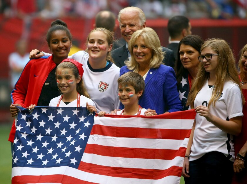 Vice President Joe Biden and Jill Biden, center, pose on the pitch with Mia Hamm, second from right, after the U.S. team's 5-2 victory against Japan in the FIFA Women's World Cup Final.