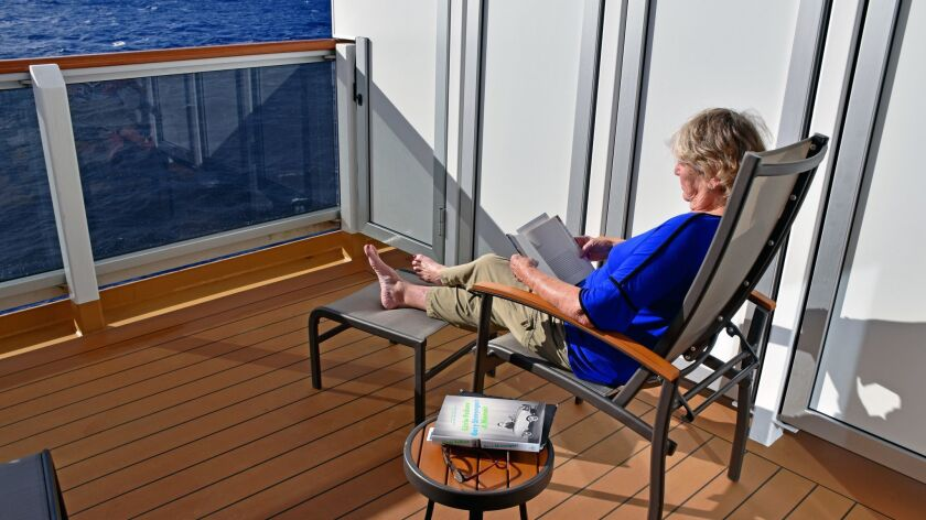 The spacious verandah of our portside cabin was a sunny retreat for reading, dozing, or just staring