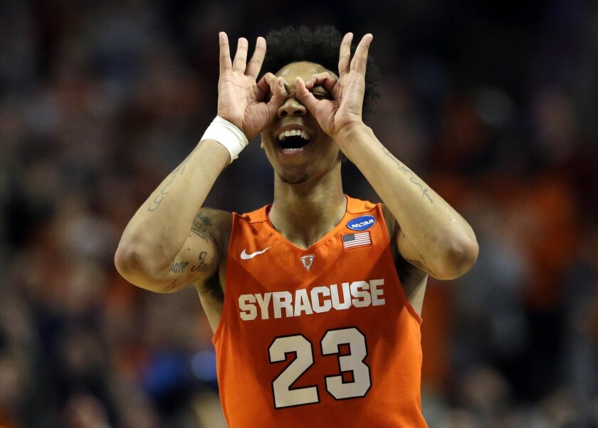 Syracuse's Malachi Richardson (23) celebrates after making three point basket during the second half of an NCAA college basketball game against Virginia in the regional finals of the NCAA Tournament, Sunday, March 27, 2016, in Chicago. Syracuse won 68-62. (AP Photo/Nam Y. Huh)