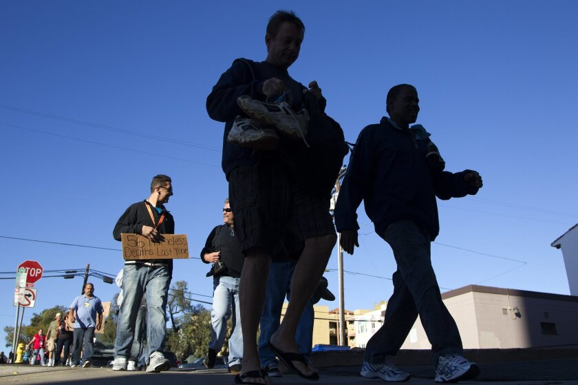 A march of over 100 people to recognize the 56 homeless people who have died in San Diego this last year took place Sunday afternoon.  The group began the march from the San Diego Rescue Mission and finished at the County Administration Center where they prayed, sang and remembered those who have
