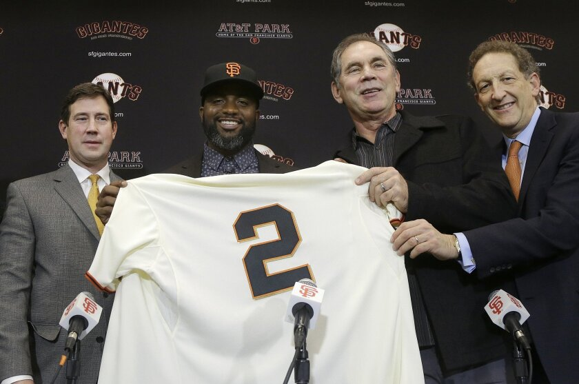FILE - In this Jan. 8, 2016, file photo, San Francisco Giants outfielder Denard Span, center left, holds up a jersey between general manager Bobby Evans, left, manager Bruce Bochy, second from right, and president and CEO Larry Baer at a news conference in San Francisco. After an offseason spending