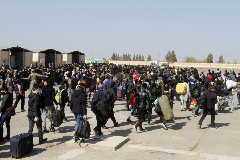 Thousands of Afghan refugees enter Afghanistan's Herat province via Iran on March 18.