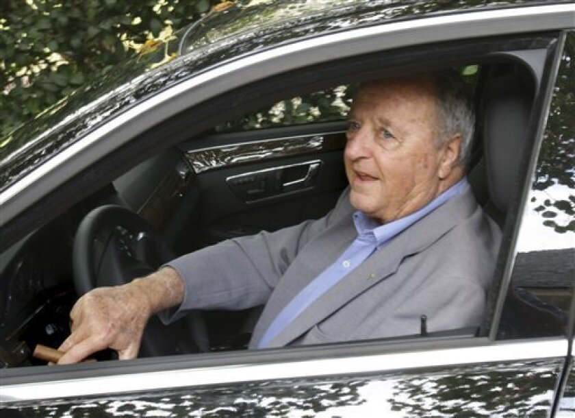 Florida State head football coach Bobby Bowden leaves his home, Tuesday, Dec. 1, 2009, in Tallahassee, Fla. Bowden would not answer questions concerning his future at Florida State.(AP Photo/Phil Coale)