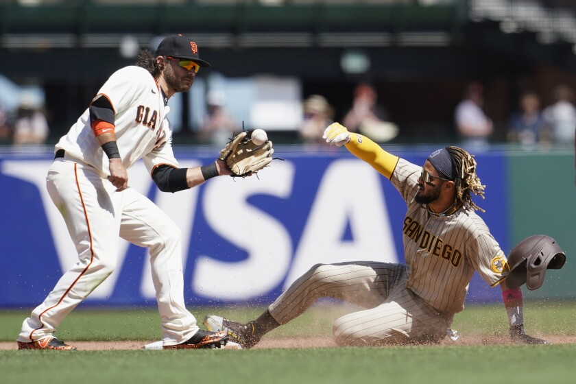Fernando Tatis Jr. steals the first of his two bases Saturday