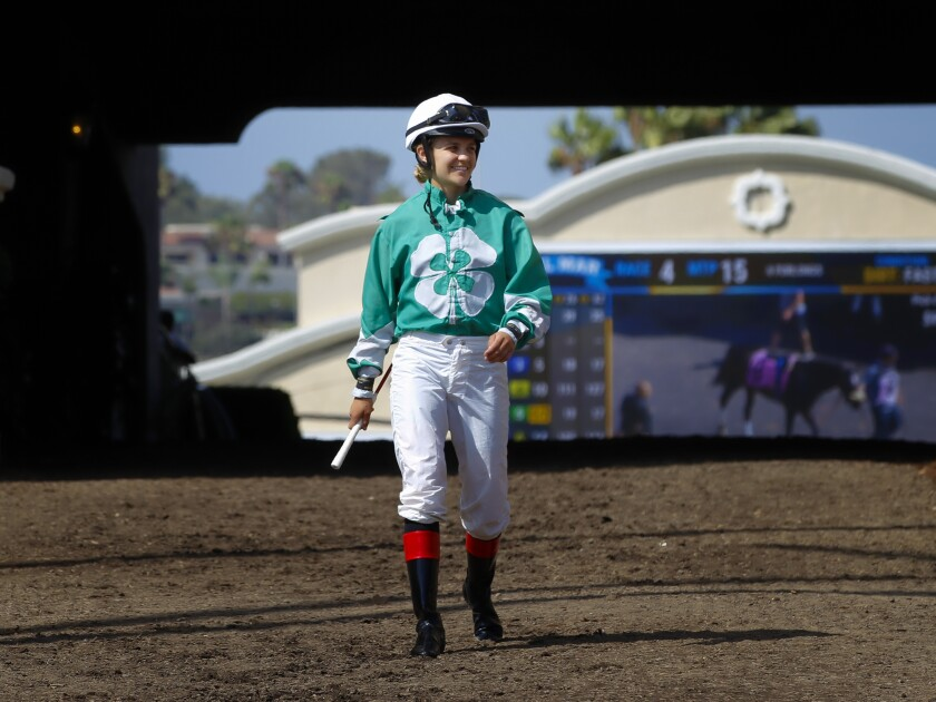 Jockey Ferrin Peterson walks towards the paddock at Del Mar Race Track just before the 4th race on August 22, 2019.
