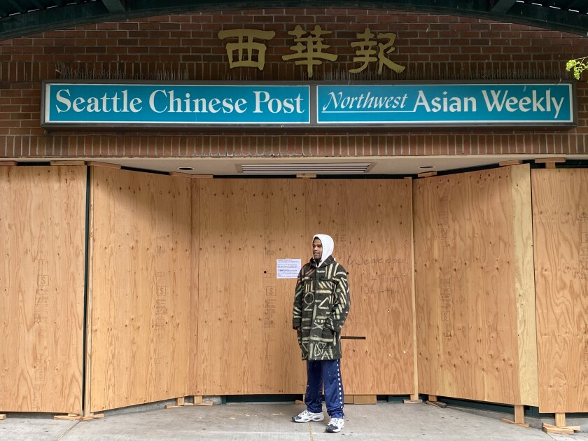 Procter may paint plywood covering Chinatown newspaper offices next.