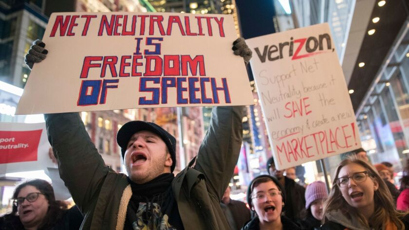 Demonstrators rally in support of net neutrality outside a Verizon store in New York on Dec. 7.