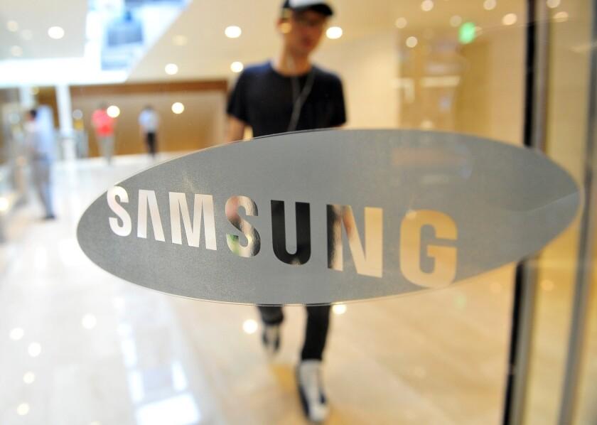 The Samsung logo on a door.