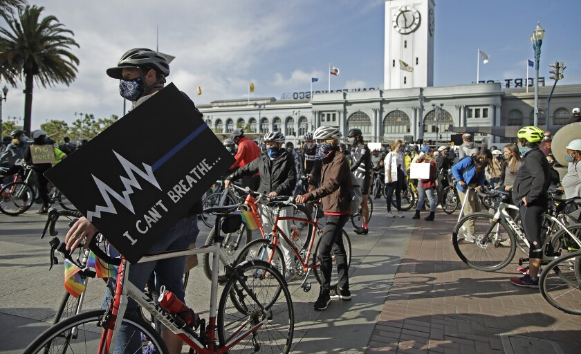Cyclists participate in a George Floyd solidarity ride June 5 in San Francisco.